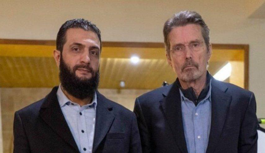 زعيم هيئة تحرير الشام (أبو محمد الجولاني) برفقة الصحفي الأمريكي (مارتن سميث).
